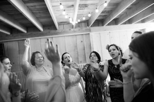 fun candid reception pictures at rustic barn wedding