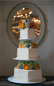 3 tier wedding cake with fall flowers