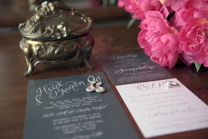 pink peonies and wedding invitation details