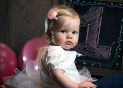 baby girl one year old portraits with chalk board