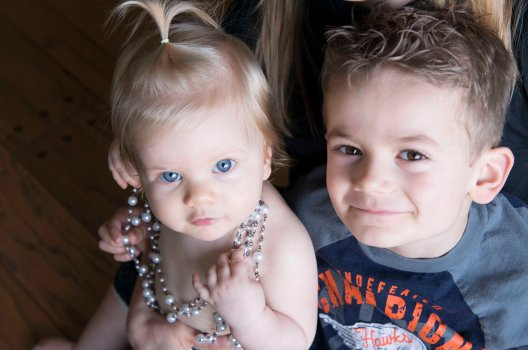 one year old sister and older brother portraits