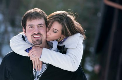engagement portrait pose girl kissing guy on cheek