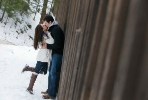 romantic engagement portrait pose girl grabs guy