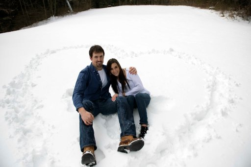 winter engagement portraits heart in the snow