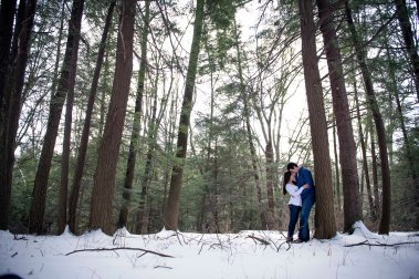 romantic winter engagement portraits in pine trees