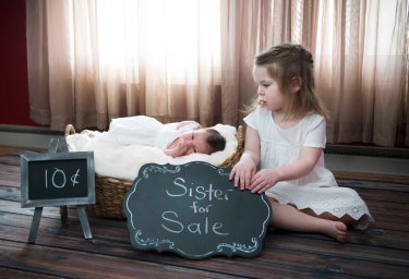 cute sibling portrait with newborn
