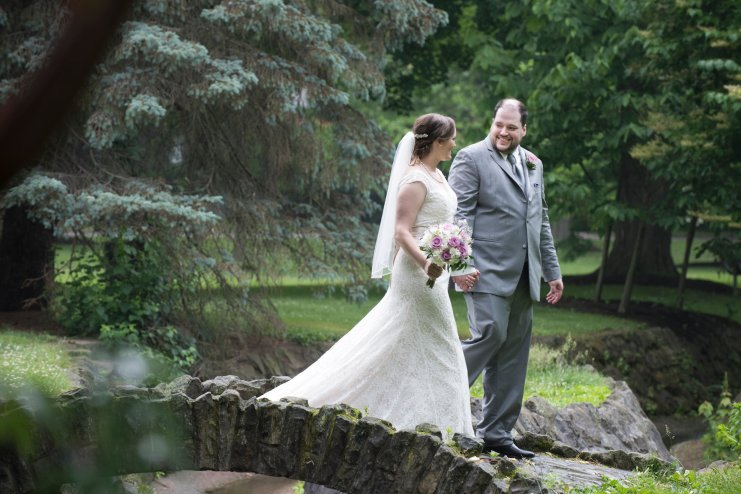 bride and groom portraits in park in Sewickley PA crossing stone bridge