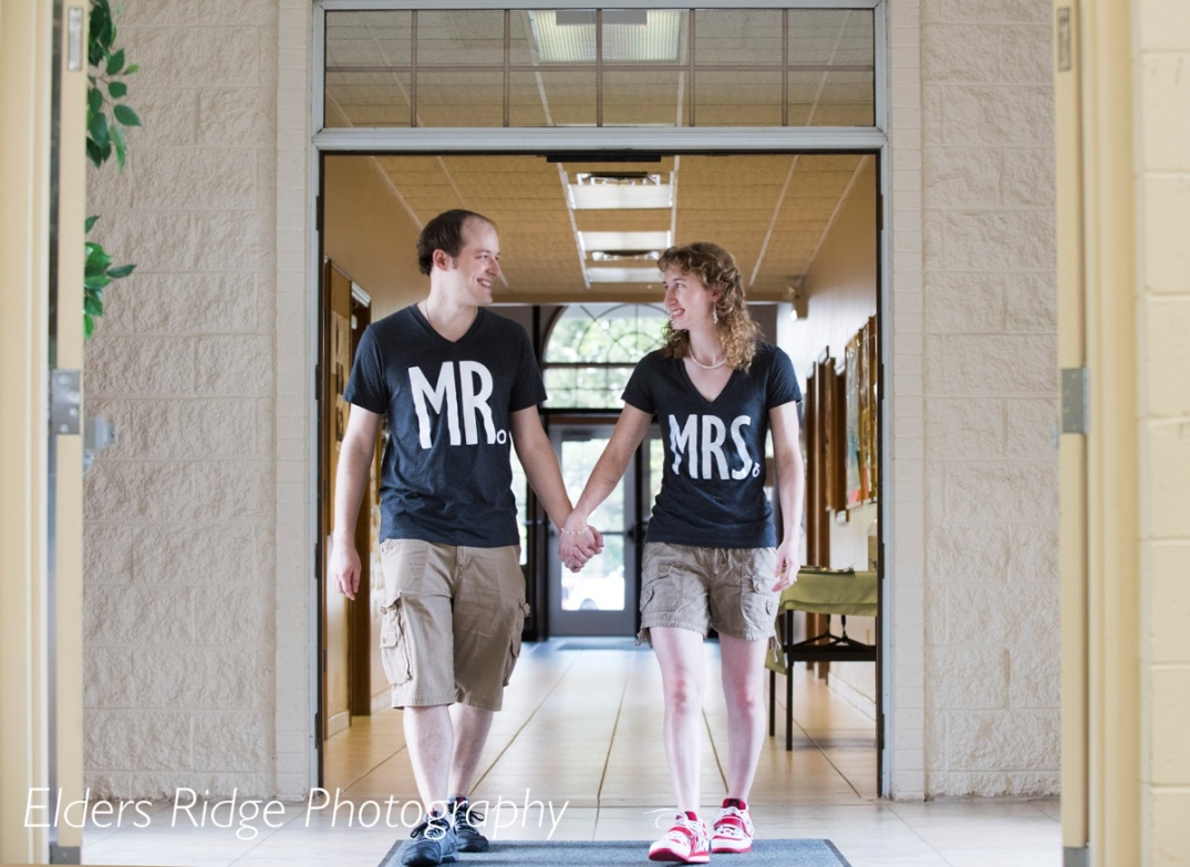 Bride and groom changed into Mr. and Mrs. t-shirts for the reception