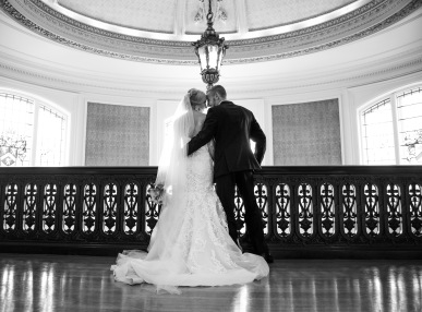 black and white bride and groom portraits inside mansion