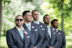 groomsmen looking tough in group pictures