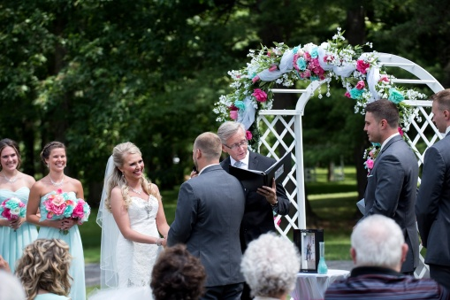 bride laughs during outside ceremony at Rustic Lodge