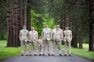 groomsmen with different colored ties and details