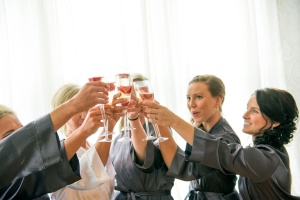 Bridesmaids toasting getting ready for wedding at Mansion at Linden Hall