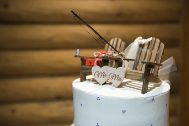 his and hers fishing wedding cake topper