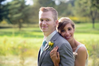 bride and groom portraits on golf course at Seven Oaks Country Club