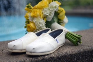 bride wears Toms shoes