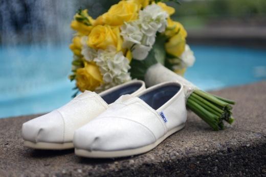 bride wears Toms shoes