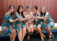bridesmaid in flowered robes drinking champagne