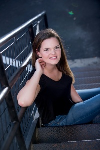 Katrina senior portraits posing on steps of a fire escape in Indiana PA