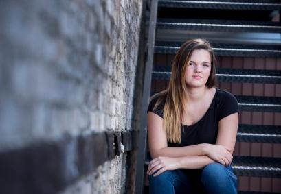 Katrina senior portraits sitting on steps in Indiana PA