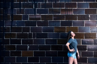 Katrina senior portraits against brick wall in Indiana PA