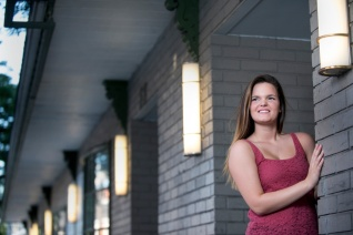 Katrina senior portraits standing outside a doorway in downtown Indiana PA