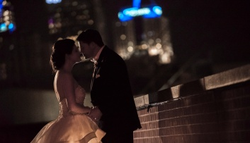 bride and groom in the city at night